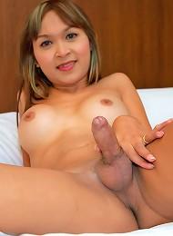 Hung ladyboy Namtan reveals her tiny red G-string