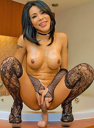 Hot t-girl in a funky bra top and patterned nylons