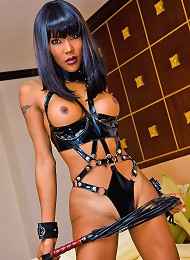 Hand-cuffed shemale-slave ready to fulfill any fantasy
