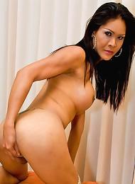 Asian ladyboy Crystal sporting unusually big boobs