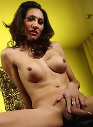Sweet brunette transsexual spreading her ass