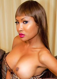 Sultry brown skinned beauty Busty May poses.