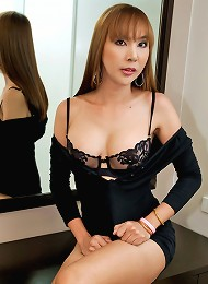 Asian tranny MILF unloads her smooth balls