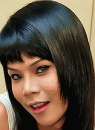 Thai Tranny spanks her cock and spunks