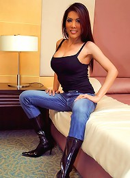 Busty ladyboy Cynthia posing in lingerie and boots